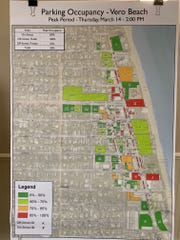 A map of parking areas in Vero Beach's beachside shopping district prepared by Kimley-Horn, planning consultants for the city, is displayed Sept. 24, 2019, at the Holiday Inn Oceanside. About 25 residents showed up Tuesday to offer the consultants feedback on the parking situation. The red areas, including Sexton and Humiston plazas, denote parking lots 85 percent to 100 percent full at 2 p.m. Thursday March 14, 2019. That was peak time for parking during Kimley-Horn's parking study.  The dark green areas are 0 percent to 50 percent full.