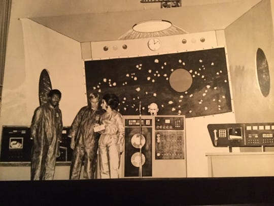 Ralph Cunningham, left, Jim Handley and Martha Lemasters put on a skit for the IBM employees and their wives in the 1960s. The stage props were built by Ken Clark, who later did work on NASA's Shuttle Program.