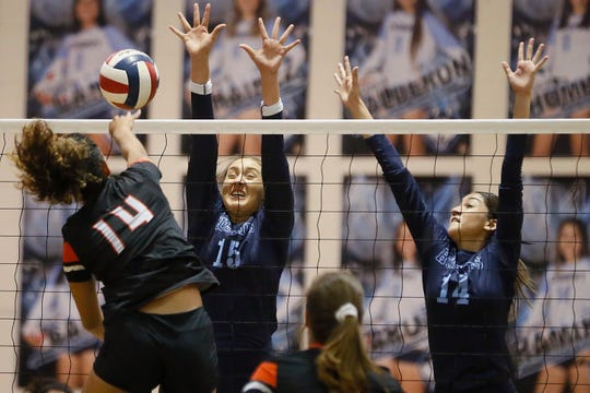 Chapin's Daniella Garcia (15) and Camila Ramirez (14) go against El Paso High's Laura Barrios Bardi (14) during the game Tuesday, Sept. 24, at Chapin High School in El Paso.