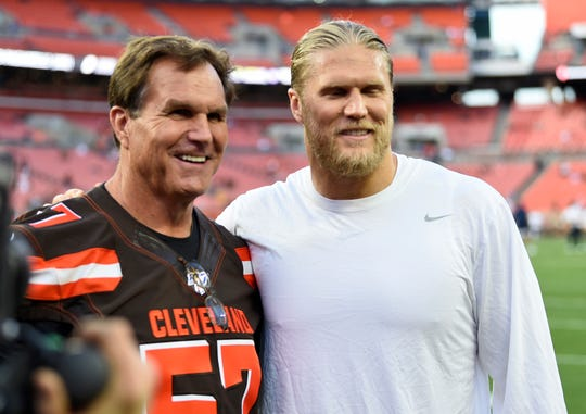 Clay Matthews Jr., left, poses with his son, Rams outside linebacker Clay Matthews III, before Sunday night's game in Cleveland. The elder Matthews was inducted into the Browns' Ring of Honor at halftime of the game.