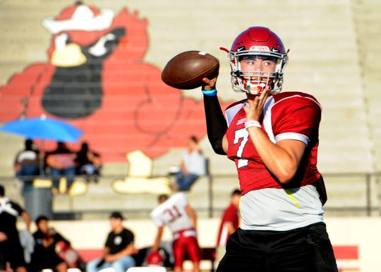 Quarterback Hector Zuniga eyes the target during Santa Paula's practice on Tuesday. Zuniga has passed for 933 yards and six touchdowns through five games for the Cardinals.