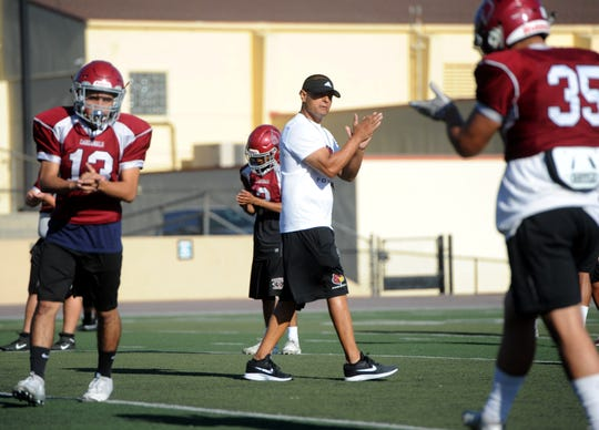 Head coach Mike Montoya encourages his team during Santa Paula's practice on Tuesday. The Cardinals will host Nordhoff on Friday night in their first Citrus Coast League game of the season.