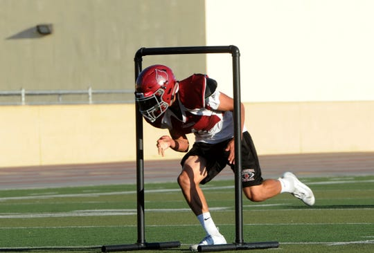 Wide receiver Victor Duran squeezes through an obstacle during Santa Paula's practice Tuesday. Duran, a senior, and the Cardinals take on Nordhoff on Friday night.