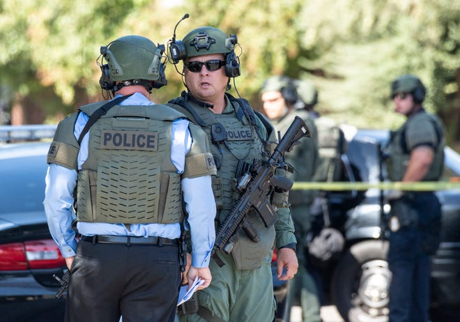 Visalia Police surround a house in the 5900 block of West Vassar Avenue on Tuesday, September 24, 2019. A domestic violence suspect was believed to be inside.