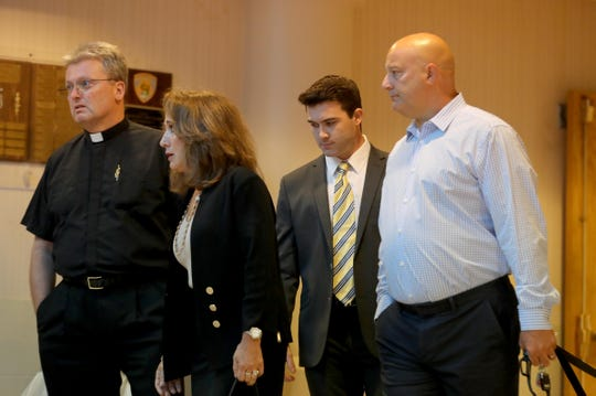 Douglas Guido of New Jersey, second from right, walks into Orangetown Justice Court Sept. 25, 2019 to be sentenced for causing the death of his friend Richard Hess with a single punch to the head outside a Pearl River bar in July 2018. Guido was sentenced to sixty days of community service and three years probation.