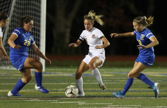 Arlington's Sofia Germano dribbles between two Mahopac defenders during the Admirals' 2-1 win on Sept. 24.