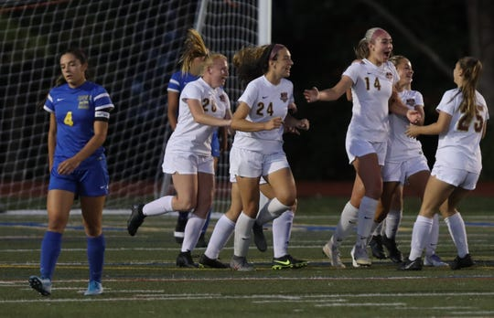 Arlington's Devon Schmitt (14) celebrates with her team after scoring the first goal during girls soccer game at Mahopac High School Sept. 24, 2019. Arlington defeats Mahopac 2-1.