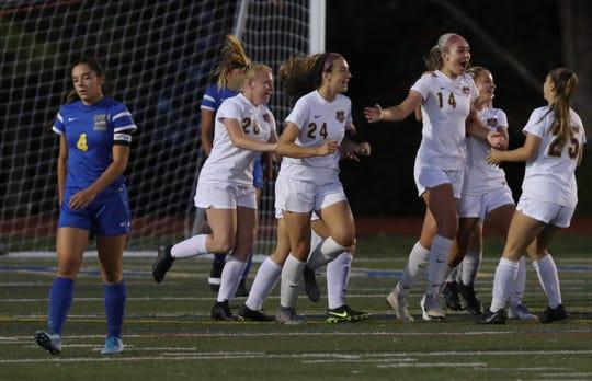 Arlington's Devon Schmitt (14) celebrates with her team after scoring the first goal during girls soccer game at Mahopac High School Sept. 24, 2019. Arlington defeats Mahopac 2-1.