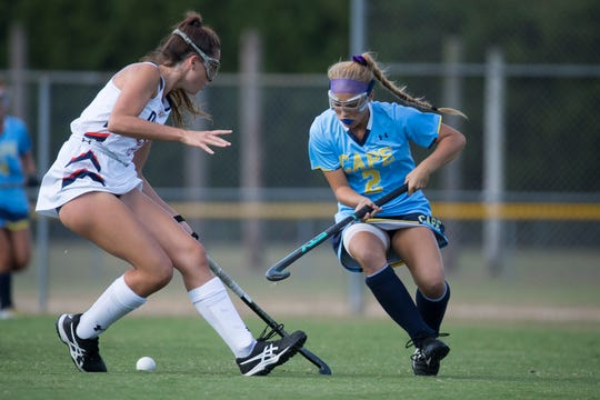 Cape Henlopen's Lily Ashby (2) cuts back against a Delmar defender on Sept. 24 at Delmar.