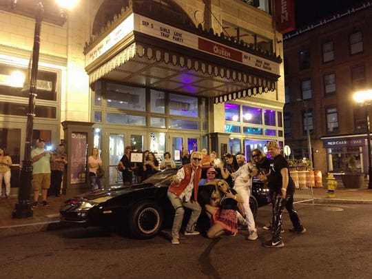 """A replica of KITT from '80s television series """"Knight Rider"""" in front of The Queen. The car, owned by Wilmington's Damian Muzzi, was there for last month's '80s party featuring a performance by tribute band The Reagan Years, which is posing with the car."""