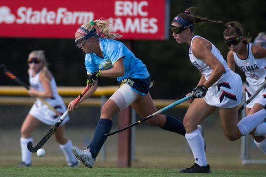 Cape Henlopen's Abigail Kane, left, carries the ball down the field last Tuesday against Delmar in a showdown of the No. 1 teams in Divisions I and II. Delmar scored a 4-0 victory at home.