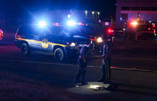 Delaware State Police investigate after a person was struck and killed by a car on US 40 near New Castle about 11:10 p.m. Tuesday.