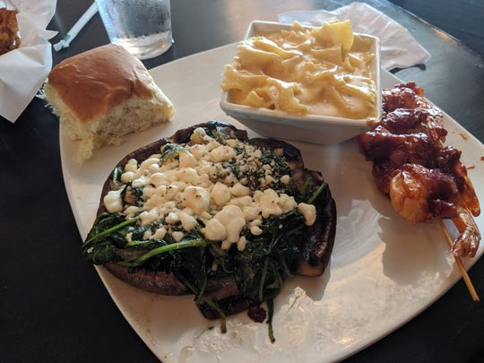 Feta and spinach stuffed portabella mushroom with mac and cheese, and bacon wrapped shrimp at JR's Chophouse B&B.