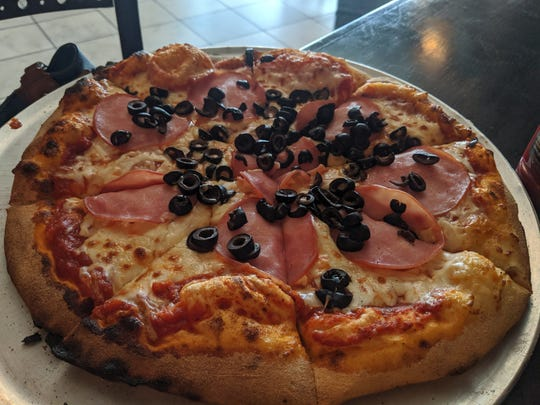 Pizza with Canadian bacon and black olives at JR's Chophouse B&B.
