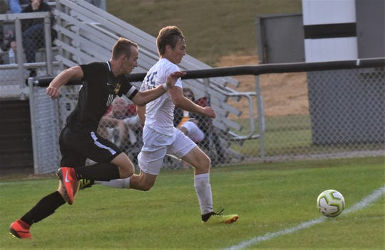 Maysville's Jonah Gahagan and Tri-Valley's Mason Dunn chase down a loose ball in the Scotties' 4-0 win on Tuesday.