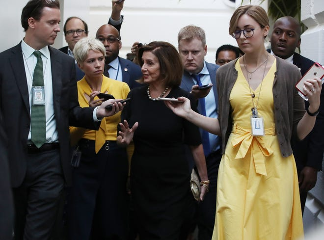 Speaker of the House Nancy Pelosi walks to a meeting with the House Democratic caucus Sept. 25, one day after she announced that Democrats will start an impeachment inquiry of President Donald Trump.