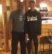 Navy offensive coordinator Ivin Jasper with his son Jarren at their home in Deep Creek, Md.