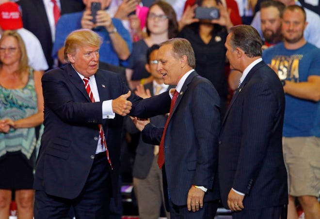 President Donald Trump greets Rep. Andy Biggs in 2017 in Phoenix, Arizona.