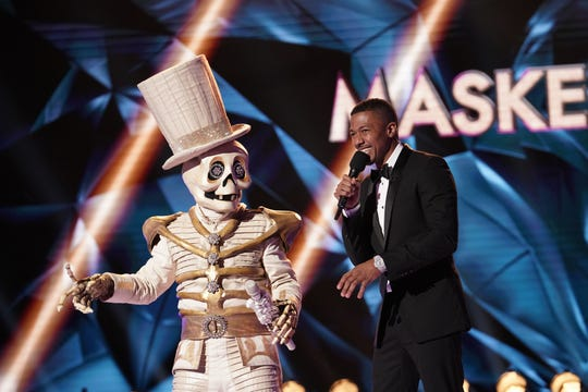 "The Skeleton and host Nick Cannon on ""The Masked Singer."""