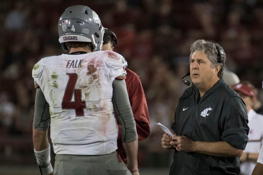 Luke Falk, now a member of the New York Jets, starred at Washington State under coach Mike Leach, right, from 2014 to '17.