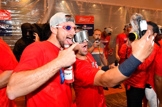 Sept. 24: Washington Nationals players Max Scherzer and Gerardo Parra celebrate after the team clinched an NL wild-card spot.