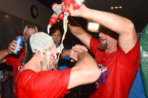 Pitcher Max Scherzer and third baseman Bob Henley celebrate.