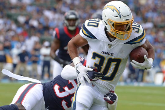 The Chargers' Austin Ekeler is tied for the most fantasy points among running backs through the first three weeks of the season, but his workload could be reduced significantly with Melvin Gordon ending his holdout.
