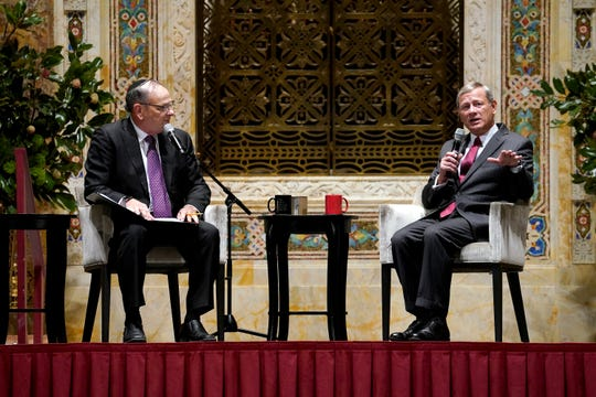 Chief Justice John Roberts answers questions from Rabbi Mark Lipson during an appearance at Temple Emanu-El in New York City on Tuesday night.