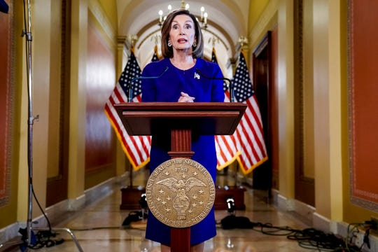 House Speaker Nancy Pelosi reads a statement announcing a formal impeachment inquiry into President Donald Trump.