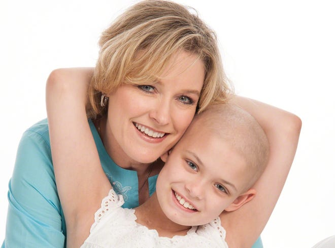 Paula and Carson Head. Carson was diagnosed with osteosarcoma on March 7, 2014,