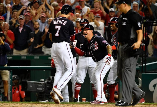 Washington Nationals shortstop Trea Turner is congratulated after hitting a grand slam against the Philadelphia Phillies.