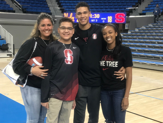 Donna Jasper, left, stands with her children (from left) Jarren, Jaylen and Dallas after Jaylen played in a volleyball game for Stanford against UCLA in 2018.