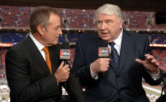 Sportscaster Al Michaels (L) and his 'Monday Night Football' announcing partner John Madden sit in the booth prior to the last ABC Monday Night Football game telecast on Dec. 26, 2005.