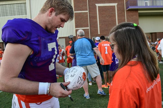 Clemson quarterback Chase Brice (7) gives an autograph during a post-practice gathering after practice in Clemson Wednesday.  ClemsonLIFE program students at Clemson University enrolls young adults with intellectual disabilities who want the college experience. The program offers two-year program to help participants with intellectual disabilities  a setting to learn and show ability to live independently. The program also has another two-year advanced program for those who have shown they can safely life independently.