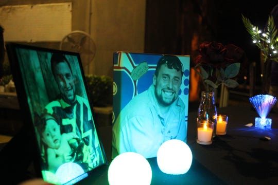 Lights shine on photos of Thomas Coutee Jr., who died on Sept. 8, 2018, after being shot at the Walmart on Coliseum Boulevard in Alexandria. Members of his family attended a vigil for homicide victims in September outside the Rapides Parish Courthouse.