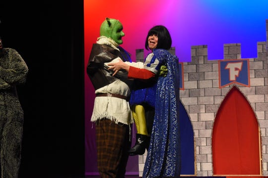 "Ross Schexnayder (left) stars as Shrek and Chris McDowell as Lord Farquaad in  Lagniappe Theatre's presentation of ""Shrek the Musical."""
