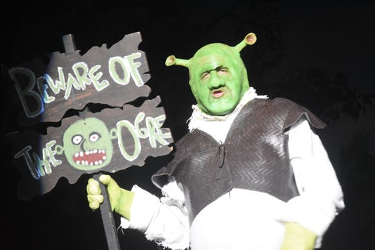 "Ross Schexnayder stars as Shrek in Lagniappe Theatre's presentation of ""Shrek the Musical."""