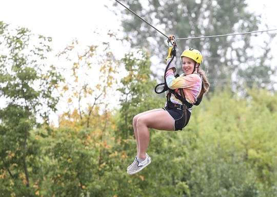 Kendra Paustian of Appleton rides the new zip line at Hofacker's Hillside Orchard in late September.
