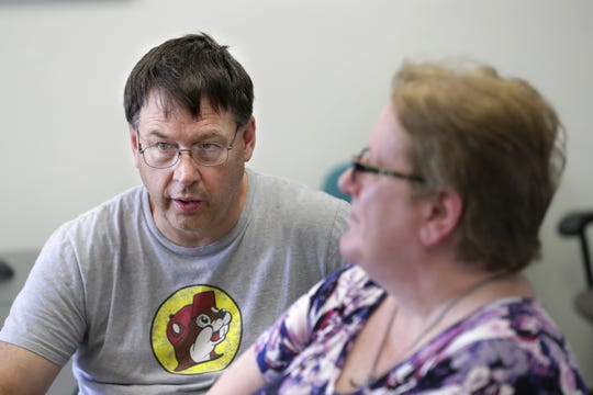 Mark Rogers talks about his daughter, Megan Rogers, during an interview with The Post-Crescent. Megan Rogers died July 29, 2017, three days after she was found severely injured on Prospect Avenue in Grand Chute. At right is Karleen Rogers, Megan's mother and Mark's wife.