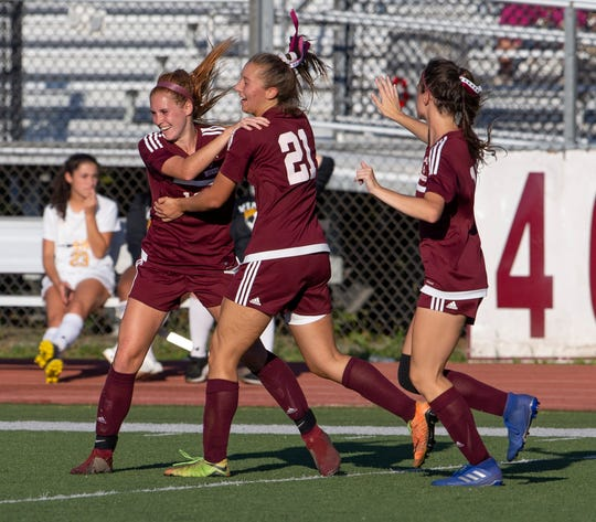 Matawan's Sara Margarites and Bryn Radvnski  celelbrate after Matawan scores its go ahead run to make the score 3-2 with minutes left. St John Vianney Girls Soccer vs Matawan High School in Aberdeen on September 25, 2019.