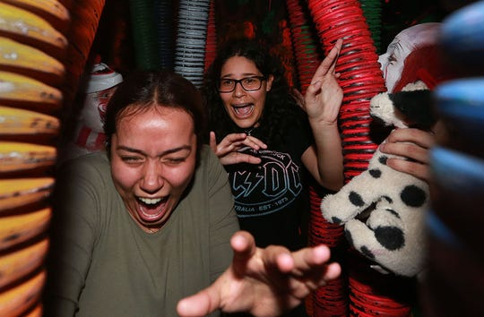 Scenes from Bane Haunted House, currently scaring visitors to its new Manhattan location.