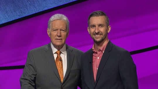 """Jeopardy!"" host Alex Trebek stands alongside contestant and Binghamton resident Kevin Boettcher."