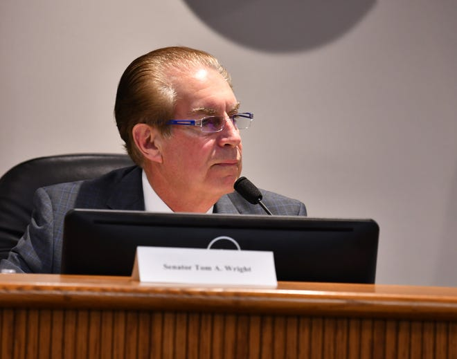 Florida Sen. Tom Wright listens to a presentation at Wednesday's meeting of the Brevard County delegation to the Florida Legislature.