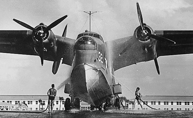 Servicemen hose down a sea plane at Naval Air Station Banana River, which in 1950 was renamed Patrick Air Force Base.
