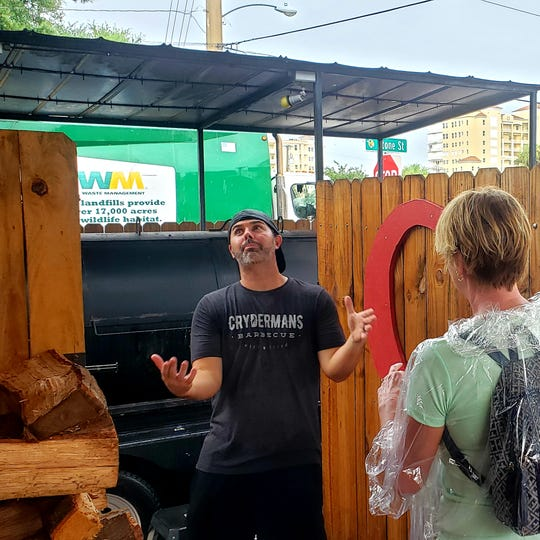 Chad Cryderman of Crydermans Barbecue in Cocoa Village gives Village Food Tour guests the lowdown about his barbecue.
