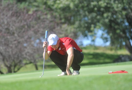 Plymouth's Brody Brown eyes his putt on the 5th hole at Valley View.
