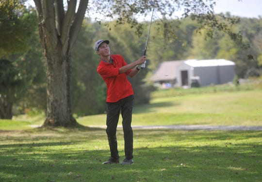 Bucyrus' Reece Zeigler hits an approach shot on the 15th hole at Valley View.