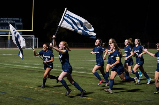 Burlington celebrates the win during the girls soccer game between the Colchester Lakers and the Burlington Sea Horses at Buck Hard field on Wednesday night September 25, 2019 in Burlington, Vermont.