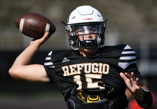Refugio's Austin Ochoa throws a pass at a football practice, Wednesday, Sept. 25, 2019. Refugio plays against Mart on Friday.