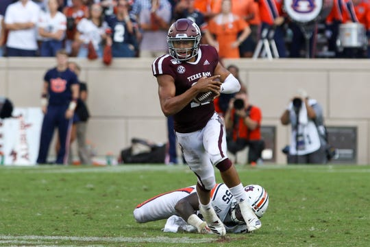 Sep 21, 2019; College Station, TX, USA; Texas A&M Aggies quarterback Kellen Mond (11) runs the ball against Auburn Tigers defensive end T.D. Moultry (55) during the fourth quarter at Kyle Field. Mandatory Credit: John Glaser-USA TODAY Sports